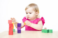 Little girl making towers Royalty Free Stock Photo