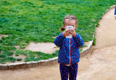 Little girl making video or photo Royalty Free Stock Photography