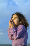 Little girl making a wish Stock Images