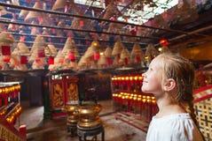 Little girl in Man Mo temple Stock Photos