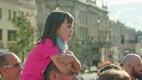 Little Girl on Man`s Shoulders Watches Performance royalty free stock photos