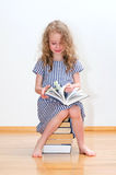 Little girl with many books. Royalty Free Stock Photography