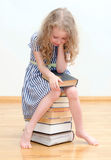 Little girl with many books. Stock Photo