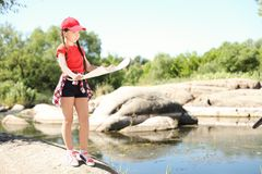 Little girl with map outdoors. Summer camp stock photography