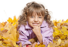Little girl with maple leaves Royalty Free Stock Images