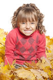Little girl with maple leaves Royalty Free Stock Photo