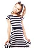 Little girl in the marine dress Stock Image