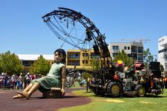 Little Girl Marionette with Winch System: Journey of the Giants in Perth, Australia. PERTH, WESTERN AUSTRALIA, AUSTRALIA-FEBRUARY 14,2015: Little girl giant Royalty Free Stock Image