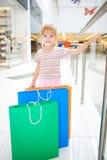 Little girl in market Stock Images