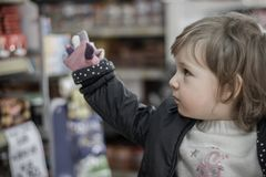 Little Girl on a Market on Royalty Free Stock Photography