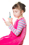 Little girl with mascara Royalty Free Stock Image