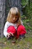 Little girl with mashroom Stock Photos