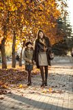 Little girl with mather outdoor. Vertical photo, happy beautiful little girl with mather walk in park Royalty Free Stock Photography