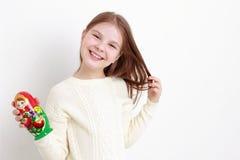 Little girl and matryoshka Stock Image