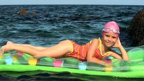 Little Girl On A Mattress In The Sea stock footage