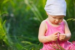 Little girl in meadow Stock Image