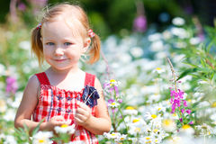 Little girl in meadow Royalty Free Stock Photography