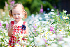 Little girl in meadow Royalty Free Stock Photos