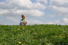 Little girl on meadow Royalty Free Stock Images