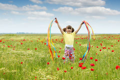 Little girl on meadow Stock Images