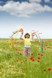 Little girl on meadow Royalty Free Stock Photos