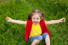 Little girl in meadow Stock Photos