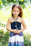 Little girl on the meadow Stock Photos