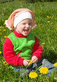 Little girl  on meadow with dandelion Royalty Free Stock Photography