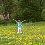 Little girl on meadow outdoor. Stock Photography