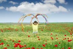 Little girl on meadow spring season Stock Image