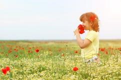 Little girl in the meadow spring season. Happy little girl in the meadow spring season royalty free stock photos