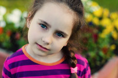 Little girl on the meadow in summer day Royalty Free Stock Photo