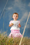 Little girl on meadow before sunset royalty free stock image