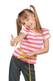 Little girl with measure Royalty Free Stock Photos