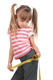 Little girl with measure Stock Photo