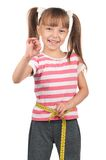 Little girl with measure Stock Images