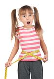 Little girl with measure Royalty Free Stock Photography