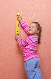 Little girl with measurement level Royalty Free Stock Image