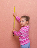 Little girl with measurement tape Royalty Free Stock Photo