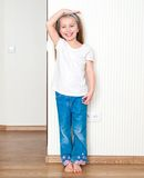 Little girl measures the growth Royalty Free Stock Images
