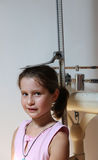 Little girl during a medical examination with medical instrument Stock Photos