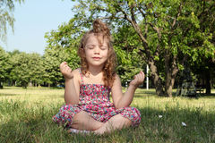 Little girl meditates Royalty Free Stock Photos