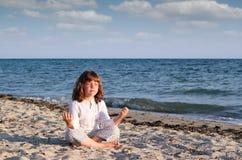 Little girl meditating Royalty Free Stock Image