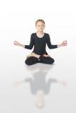Little girl meditating. Little girl doing yoga on white background Royalty Free Stock Photo
