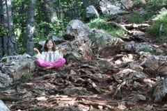 Little girl meditating Stock Photography