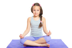 Little girl meditating Stock Photos