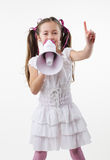 Little girl and megaphone. Smiling young little girl with megaphone Stock Photos