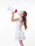 Little girl and megaphone. Young little girl shouting through megaphone Royalty Free Stock Photos