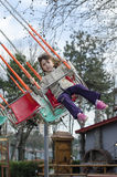 Little girl in a merry-go-round Stock Images