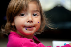 Little Girl Messy Face From Eating Dessert Stock Images